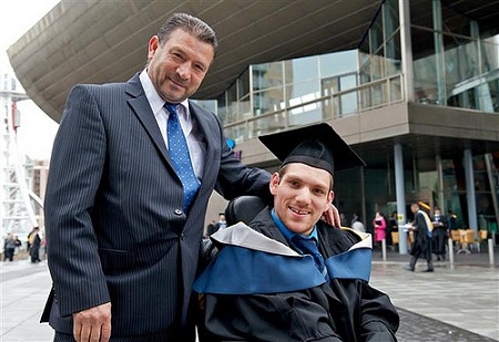 Image That Shows A Disabled Student With His Father During Graduation.