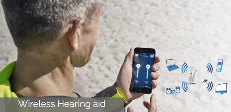 Image That Shows An Old Man Experiencing Wireless Hearing Aid Technology Over His Phone.