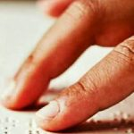 Image Showing Visually Impaired Person Reading Some Text.