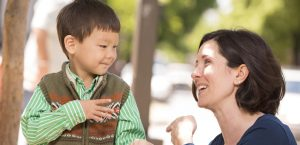 A Mother Talking Via Sign language To Her Cute Little Kid.