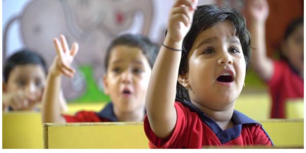 School Kids Speaking By Using Sign Language.
