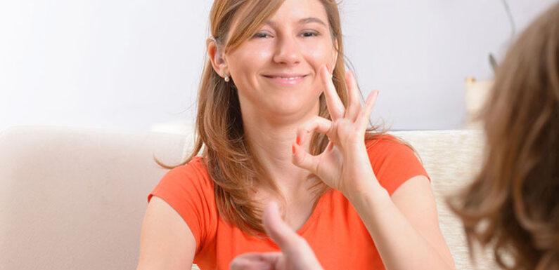 Learning sign language.